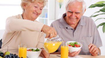 Elderly Couple Drinking Juice